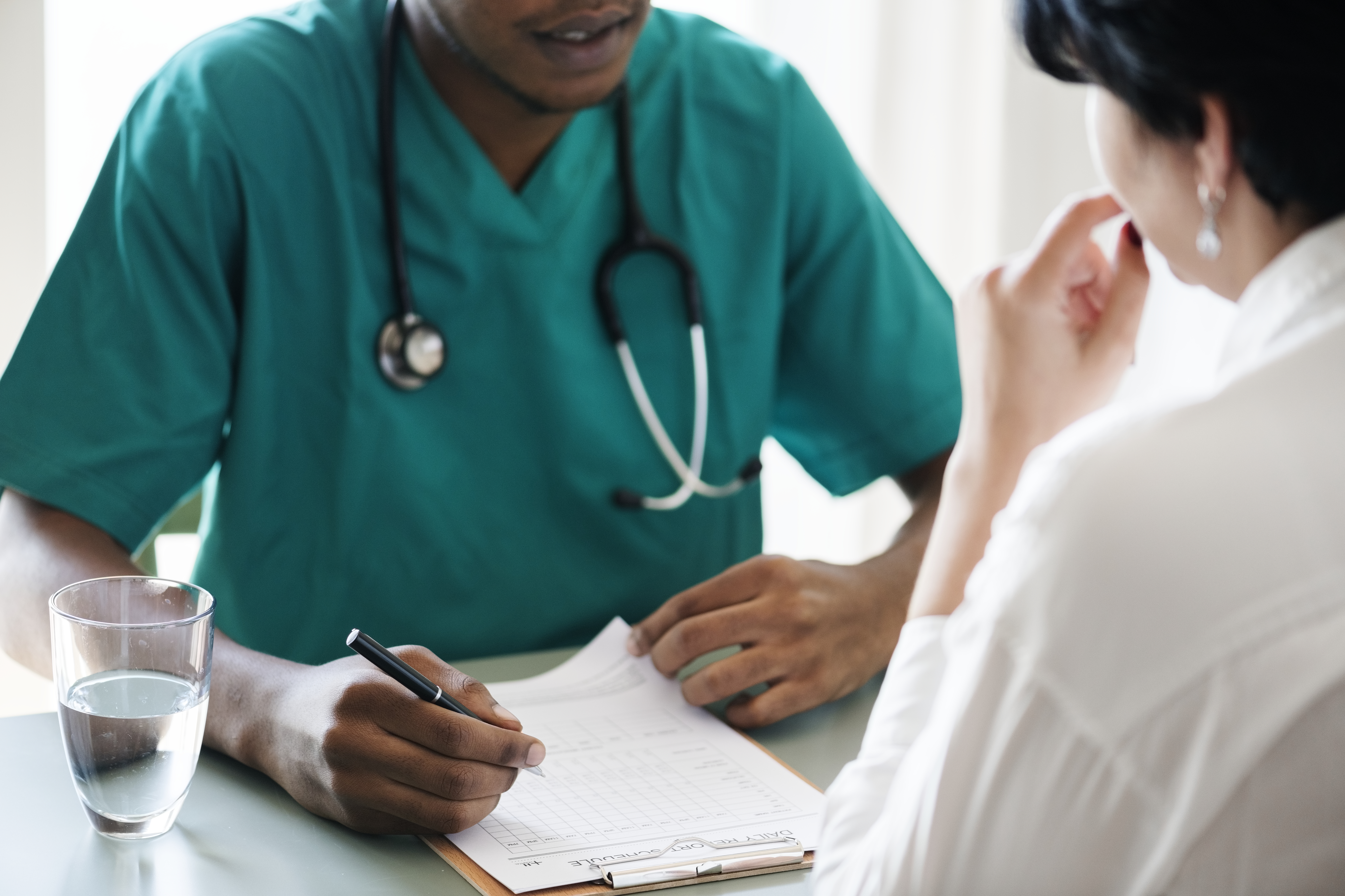 Doctor diagnose patient symptoms at the hospital